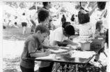 Photograph of children at Placentia Historical Committee activity booth.