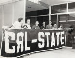 """Students holding up a banner which reads """"CAL-STATE"""""""