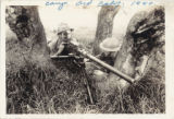 Photographic postcard of two soldiers with a machine gun