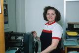 Woman working at a printer