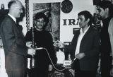 University President Fred Harcleroad holding a hookah