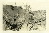 A suspended bridge at the Old Don Pedro Dam construction site, circa 1922.