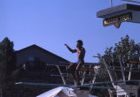 [Diver of the Mission Viejo Nadadores preparing to dive from diving board slide].