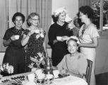 Pat Nixon and local group of women at a social tea in Banning, California