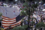 [1984 Olympics Cycling Road Race showing large American flag and spectators slide].