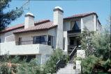 [La Mancha Townhomes model home exterior, plan 22 slide].