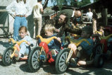 [Children on Big Wheel tricycles at Great Bike Race of 1973 slide].