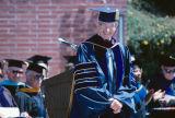Slide of President Ellis McCune during a graduation ceremony.