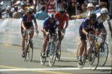 [1984 Olympics Women's Cycling Road Race showing Connie Carpenter, Rebecca Twigg, and three international competitors racing in a pack slide].