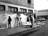 Photograph of art students painting wall mural