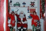 [Santa Claus and elves inside Santa's Work Shop, 1974 slide].