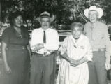 Four individuals at a Pioneer Picnic in Banning, California, including Bert and George Bailiff