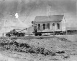 Moving wing of Old Murray School to cemetery location (1975), photograph