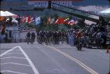 [1984 Olympics Women's Cycling Road Race with cyclists racing over finish line slide].