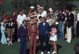"[Doug Sanders, Vin Scully, Laura Baugh at ""Challenge of the Sexes"" golf competition, 1975 slide]."