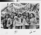 "[Riders from the ""Baubles, Bangles and Beads"" 1980 Rose Parade float from Mission Viejo photograph]."