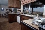 [New Madrid model home kitchen slide].