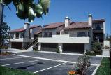 [La Mancha Townhomes model home exterior, multiple units slide].