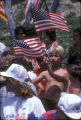 [1984 Olympics Cycling Road Race showing boys waving American flags slide].