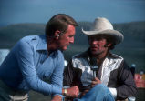 """[Vin Scully interviewing rodeo event participant at """"Challenge of the Sexes,"""" 1976 slide]."""