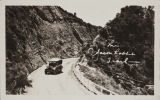 Postcard of old time car driving on Jack Rabbit Trail.