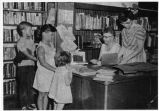 Upland Photograph Public Services; Upland Public Library (Carnegie) two staff members helping 3 children