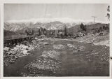 Flood picture from 1969.  View of mountains, depicting wash.  Backhoe in distance.