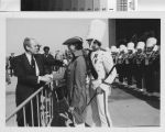 [President Gerald Ford shaking hands with a Mission Viejo High School Marching Band member photograph].