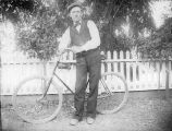 Man and bicycle, (c. 1901), photograph
