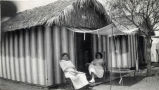 Two women sitting outside tent at Tent City, Coronado, Calif. c. 1910.