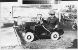 Photograph of Don Burtis and first car