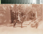 Leslie C. Brand on a horse