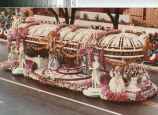"""[""""Versailles"""" 1982 Rose Parade float from Mission Viejo photograph]."""