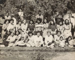 Young Men and Women Gathered for a Picnic