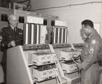 Photograph of two soldiers in the communications room
