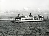 The end of an era, one of the last ferries to transport automobiles crosses the San Diego Bay, 1969.