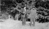 """Roger """"Rod"""" Fallon (1853-1932) and an unidentified man standing in a meadow, (c. 1929), photograph"""