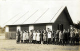 Coronado's seventh grade class stands in front of temporary classroom 1912 – 1913.