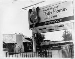 Photograph of sign advertising Palm Village Patio Homes.