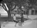 [Two female students in the quad]