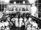 Upland Photograph Agriculture--Citrus; Citrus workers posing in packing house / Edna Swan