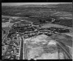 [Aerial photograph of Deane Homes models and houses, Monterey Homes models, Mission Viejo High School, and La Paz Homes models, circa 1966].