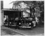 Upland Photograph Public Services; Upland Police Department: police vehicles and police officers at police station