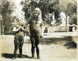 Two young girls standing outdoors at Tent City, Coronado, Calif. c. 1904.