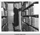 Elizabeth McCloy, College Librarian, Occidental College, in the stacks