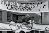 Photograph of the Pioneer Heights Dedication Ceremony ribbon cutting with President Ellis E. McCune and unknown girl (student).