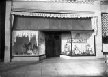 Upland Photograph Business; Exterior view of the window decorated for Christmas of the E. H. Haury & Co. Dry Goods and Variety Store / Edna Swan