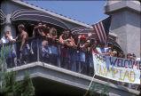 [1984 Olympics Cycling Road Race spectators on balcony slide].