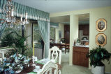 [La Mancha Townhomes model home dining areas slide].