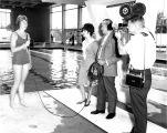 TV Crew Interviews Swimmer at Aquatorium